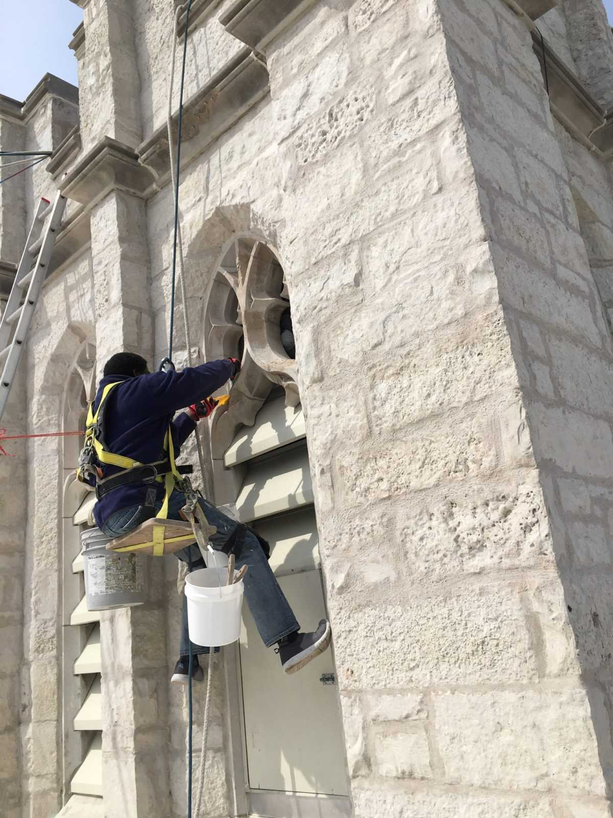 Steeplejack working on tower
